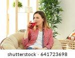 Beautiful Woman Drinking Fresh...