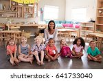 portrait of teacher with pupils ... | Shutterstock . vector #641733040