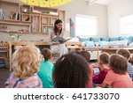 teacher at montessori school... | Shutterstock . vector #641733070