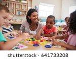 teacher and pupils using flower ... | Shutterstock . vector #641733208