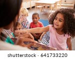 pupils at montessori school... | Shutterstock . vector #641733220