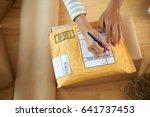 hands of woman writing address... | Shutterstock . vector #641737453