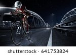 Small photo of Sport backgrouns. Athletic woman cycling road bike in the evening. Dramatic view of the night city.