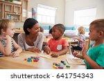 teacher and pupils using wooden ... | Shutterstock . vector #641754343