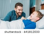 happy dad and son having fun... | Shutterstock . vector #641812033