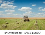 tractor collects dry hay on the ... | Shutterstock . vector #641816500