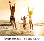 happy family jumping on the... | Shutterstock . vector #641817370