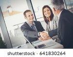 smiling businessmen shaking... | Shutterstock . vector #641830264