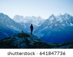 man looking at the mountains... | Shutterstock . vector #641847736