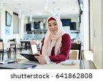 beautiful muslim woman in cafe... | Shutterstock . vector #641862808