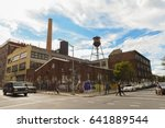 Small photo of Williamsburg, Brooklyn, United States - September 3, 2016: People walking along Berry street in Williamsburg, Brooklyn on a beautiful Weekend afternoon.