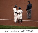 Small photo of SAN FRANCISCO, CA - OCTOBER 20: Roberto Kelly talks to Cody Ross after he was hit by a pitch game 4 of the 2010 NLCS between Giants and Phillies Oct. 20, 2010 AT&T Park San Francisco, CA.