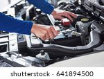 hands of car mechanic with... | Shutterstock . vector #641894500