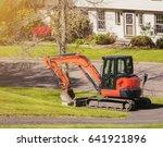 Excavator On Urban Street With...