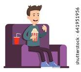 man watching movie | Shutterstock .eps vector #641951956