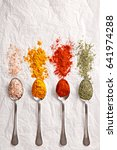 spices in silver spoons viewed... | Shutterstock . vector #641974288