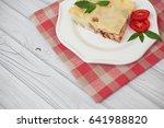 portion of tasty lasagna on... | Shutterstock . vector #641988820