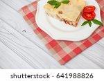 portion of tasty lasagna on... | Shutterstock . vector #641988826