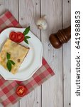 portion of tasty lasagna on... | Shutterstock . vector #641988853