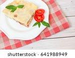 portion of tasty lasagna on... | Shutterstock . vector #641988949