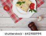 portion of tasty lasagna on... | Shutterstock . vector #641988994