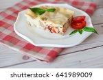 portion of tasty lasagna on... | Shutterstock . vector #641989009