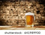 fresh beer and dark desk space  | Shutterstock . vector #641989930