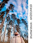 a woman looks at the sky near...   Shutterstock . vector #642014410
