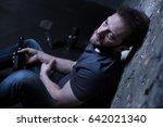 sad alcoholic expressing... | Shutterstock . vector #642021340