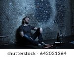 Small photo of Dope addicted man sitting in the dark lighted basement