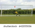 young boy playing soccer as a... | Shutterstock . vector #642055036