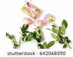 Small photo of Happy bday wishes greeting card for woman. Bouquet of three pink roses and a gift box for a woman. Conception of congratulations for Birthday, Valentine's Day. Flatlays, top view photography