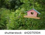 Bird house with heart shaped entrance - stock photo