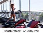 woman running on treadmill at a ... | Shutterstock . vector #642082690