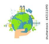 earth in hand. solar energy ... | Shutterstock .eps vector #642111490