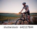 cyclist at sunset | Shutterstock . vector #642117844
