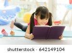 cute little girl is reading a... | Shutterstock . vector #642149104
