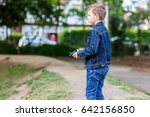 boy plays with his drone in the ... | Shutterstock . vector #642156850