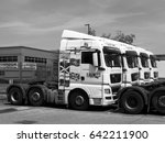 Small photo of Feltham, Middlesex, England - May 10, 2017: Monochrome Saints Transport parked lorries, largest privately owned airfreight haulier within the UK, company founded in 1968