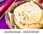 fresh white corn tortillas in... | Shutterstock . vector #642223318