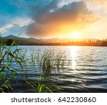 lake and mountain scenery at... | Shutterstock . vector #642230860