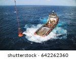 supply boat transfer cargo to... | Shutterstock . vector #642262360