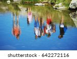 people reflected in the water.... | Shutterstock . vector #642272116