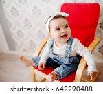 cute toddler in a chair  posing ... | Shutterstock . vector #642290488