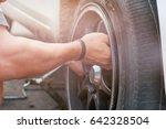change a flat car tire on road...   Shutterstock . vector #642328504