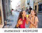two cute little girls eating... | Shutterstock . vector #642341248