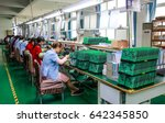 Small photo of JIANGXI CHINA-May 13, 2014: Jiangxi Shanshui Photoelectric Co., Ltd. research factory workshop, information engineers are developing computer chips, electronic workers put chips on the circuit board.