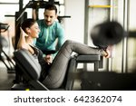 young woman exercise in a gym... | Shutterstock . vector #642362074