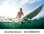 happy woman sits on surfboard... | Shutterstock . vector #642388690