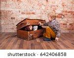Two Boys Play Hide And Seek In...
